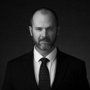 Black and white portrait photo of Thomas J. Henry Attorney Spencer J. Breunig