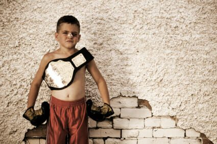 kid with bandage on nose with a wrestling belt and boxing gloves