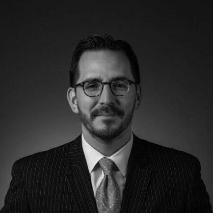 Black and white portrait photo of Thomas J. Henry Attorney Steven G. Marquez