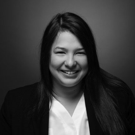 Black and white portrait photo of Thomas J. Henry Attorney Veronica Trevino Tellez